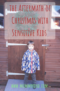 Christmas with sensitive kids - Mental Health Monday - title image - young boy outside a Christmas grotto